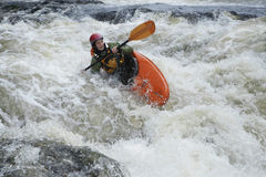 Woman kayaking in river Royalty Free Stock Images