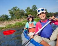 Woman kayaking Stock Images