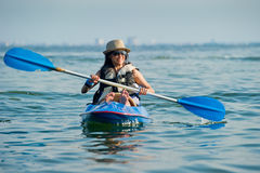 Woman kayaking in a tropical sea Royalty Free Stock Photos
