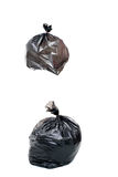 Woman Keep garbage in bag for eliminate. Woman hand carry garbage in plastic bag for eliminate on the white background Stock Photo