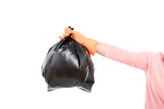 Woman Keep garbage in bag for eliminate. Woman hand carry garbage in plastic bag for eliminate on the white background Stock Photography