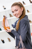 Woman keeping brown leather shoe Royalty Free Stock Images