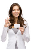 Woman keeping business card and ok gesturing Royalty Free Stock Photo