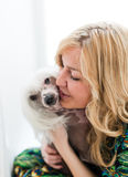 Woman keeping Chinese crested dog Royalty Free Stock Photography