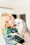 Woman keeping Chinese crested dog Stock Images