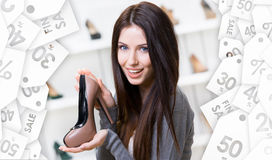 Woman keeping coffee-colored shoe. Christmas sale Stock Photo