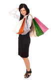 Woman keeping coloured shopping bags Royalty Free Stock Photo