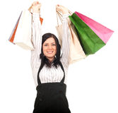 Woman keeping coloured shopping bags Stock Photo