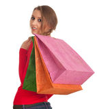 Woman keeping coloured shopping bags Royalty Free Stock Images