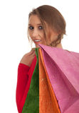 Woman keeping coloured shopping bags Royalty Free Stock Image
