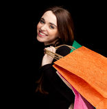 Woman keeping coloured shopping bags Stock Photos