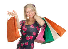 Woman keeping coloured shopping bags Stock Image