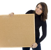 Woman keeping cork board Stock Image