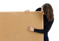 Woman keeping cork board, pointing Stock Photography