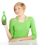 Woman keeping green bottle of beer Royalty Free Stock Image