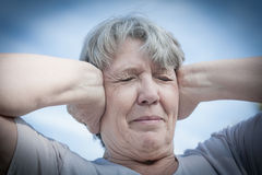 Woman keeping her ears shut Royalty Free Stock Photos