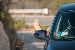 Feet out of a car royalty free stock images