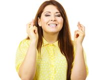 Woman keeping her fingers crossed stock photos