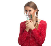 Woman keeping inhale mask Royalty Free Stock Photo