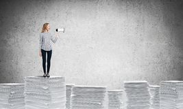 Woman keeping megaphone in hand. Royalty Free Stock Photo