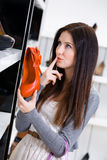 Woman keeping a pump at the shop Stock Images