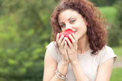 Woman keeping red apple Royalty Free Stock Photos