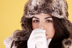 Woman keeping warm. Stock Image
