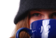 Woman keeping warm with cup of soup or coffee Royalty Free Stock Photos
