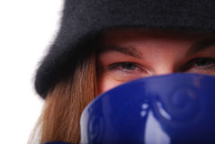 Woman keeping warm with cup of soup or coffee Royalty Free Stock Images