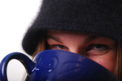 Woman keeping warm with cup of soup or coffee Stock Images