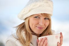Woman keeping warm Stock Photography