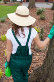 Woman keeping watering can Stock Images