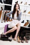 Woman keeps credit card in footwear shop Stock Image