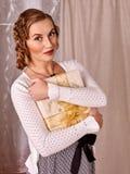 Woman keeps gift box. Retro style sepia. Portrait of woman keeps gift box at home. Retro style sepia Stock Image