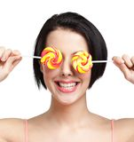 Woman keeps lollypops on the eyes Royalty Free Stock Images