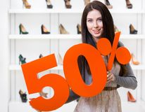 Woman keeps the model of 50% sale on shoes Royalty Free Stock Photos