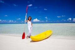 Woman keeps paddle at the seashore Stock Images