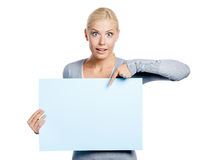 Woman keeps and points at the copyspace Stock Photo