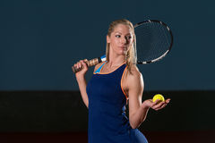 Woman Keeps Tennis Racket And Ball On Shoulders Royalty Free Stock Images