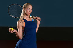 Woman Keeps Tennis Racket And Ball On Shoulders Royalty Free Stock Image