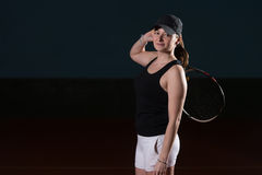 Woman Keeps Tennis Racket On Shoulders Royalty Free Stock Photos