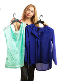 Woman keeps two blouses and can't choose the one for her stock images