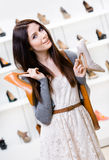 Woman keeps two shoes in the shopping mall Royalty Free Stock Photo