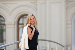 Woman keeps a white jacket Stock Photo