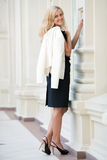 Woman keeps a white jacket Stock Photography