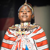 Woman From Kenya. A Woman from Kenya dressed in native clothes and accessories at the Holday Folk Fair International at State Fair Park in Milwaukee, WI stock photography