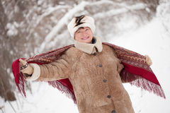 Woman with  kerchief in winter. Happy mature woman with  kerchief in winter Royalty Free Stock Photography