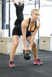 Woman with kettlebell at the fitness gym Stock Photo