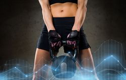 Woman with kettlebell in gym Stock Photo