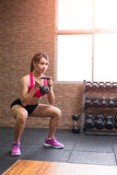 Woman with kettlebell Royalty Free Stock Photography